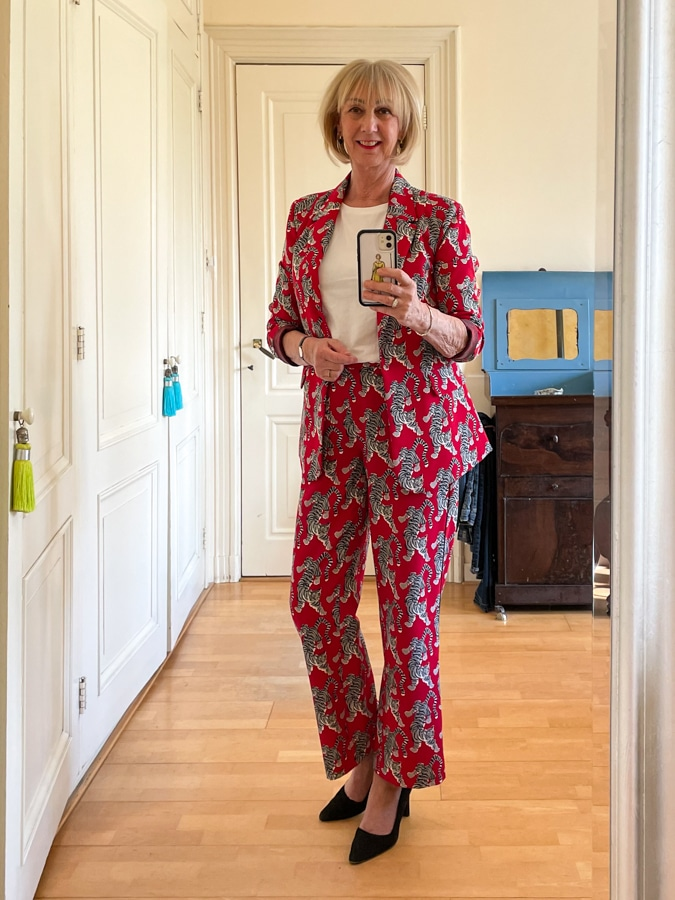 Red trouser suit with tigers