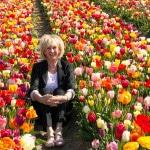 Black trouser suit in the Dutch tulip fields