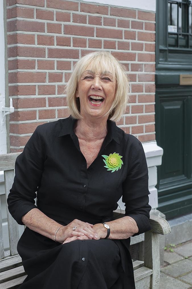 Black linen dress with green brooch by Sylvia Blickman