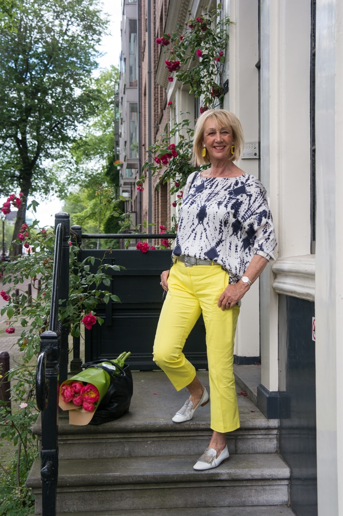 Blue and white top with yellow trousers