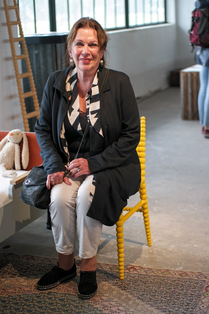 Monique sitting on the yellow chair at the OBJECT exhibition