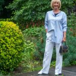 Wide white trousers styled with a blue shirt and a blue top