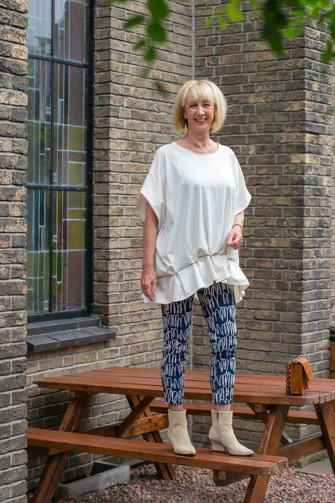 Cream top with artsy vibe and patterned trousers