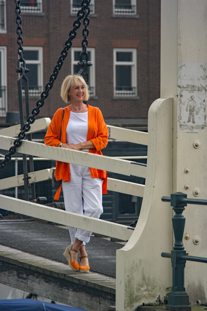 Orange jacket with white trousers