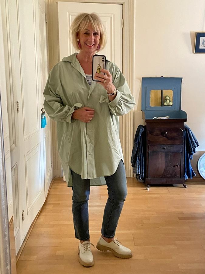 Light green oversized shirt on jeans