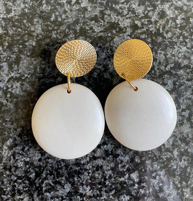 White earrings by Lara Design