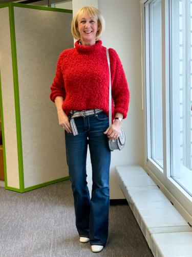 Big red jumper on flared jeans