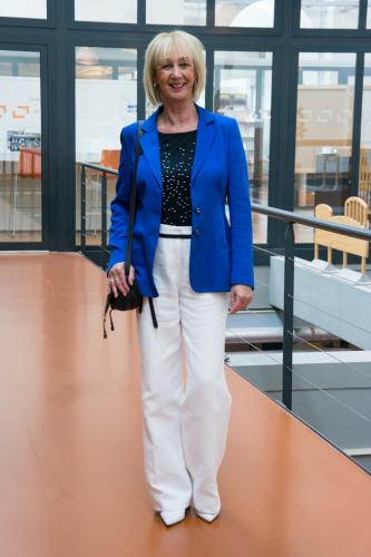 Bright blue jacket with white trousers