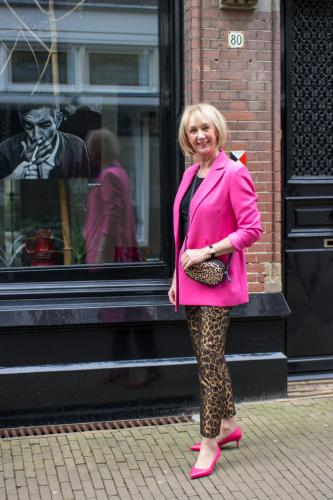 bright pink jacket with leopard trousers
