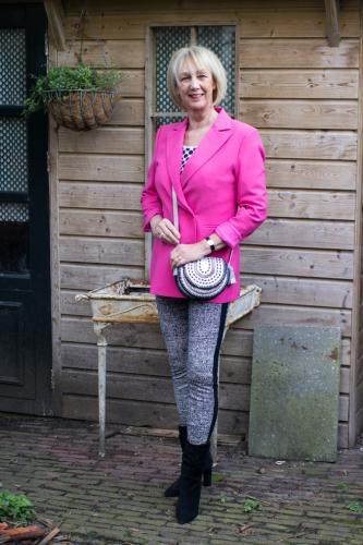Bright pink jacket with houndstooth legging