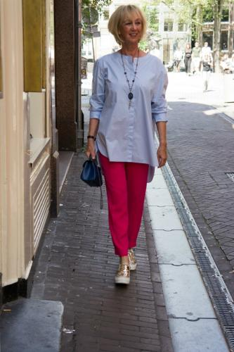 Bright pink trousers with baby blue shirt