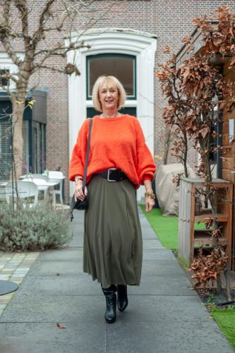 Long green skirt with orange jumper