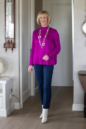 Birght purple blouse on 7/8 blue trousers
