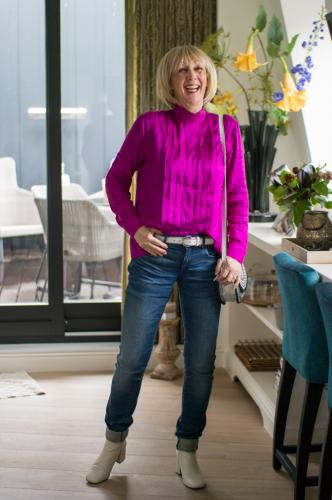 Bright purple blouse on jeans