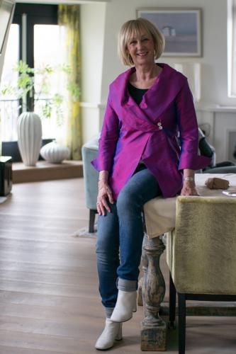 Bright purple jacket on jeans