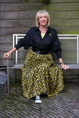 Yellow and black pleated skirt with black shirt