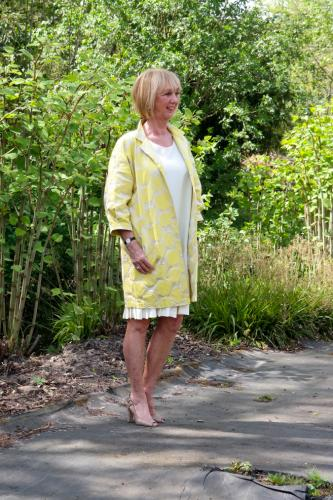 Yellow sleeveless dress with yellow jacket