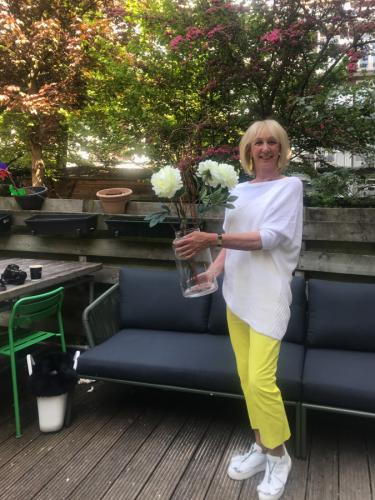 Bright yellow trousers with a white jumper
